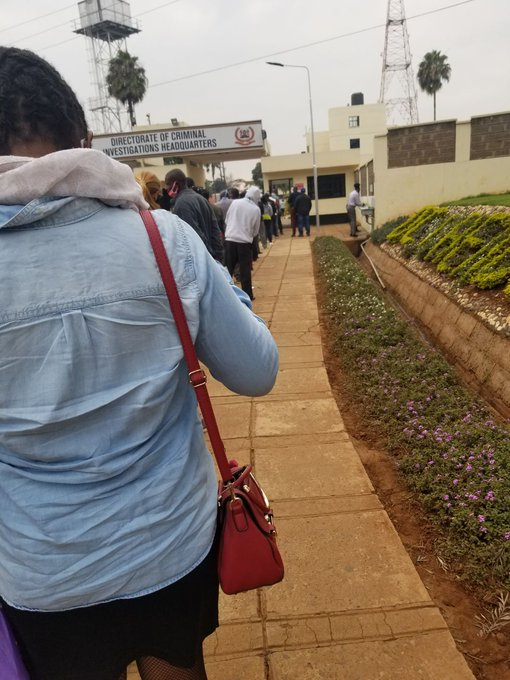 Duped Kenyans who fell victim to Urithi Housing Sacco's trap line up at the Directorate of Criminal Investigations (DCI) Headquarters along Kiambu Road, Nairobi on Wednesday, July 8 2020