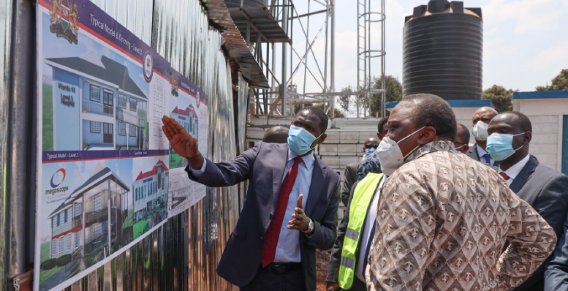President Uhuru Kenyatta alongside KMPDU Secretary General Dr Ouma Oluga during the commissioning of the project.