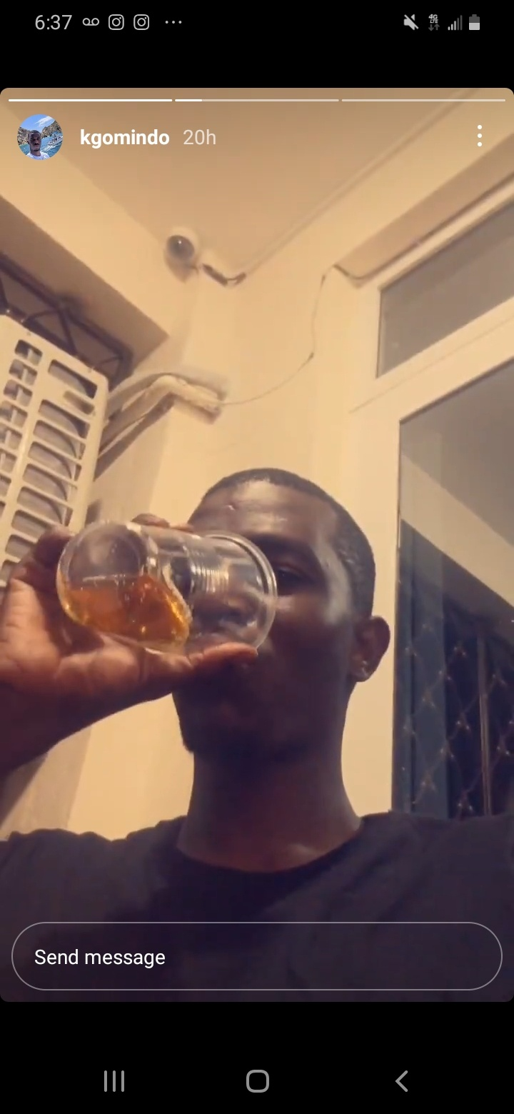 CAPTION: Kevin Omindo enjoys a drink inside his Mombasa apartment as shared on his Instagram page